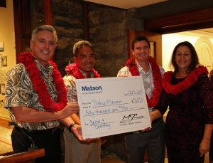 Bishop Museum staff accept faux check from Matson executives.