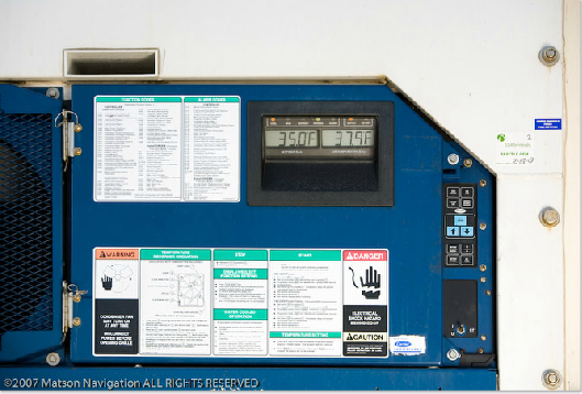 Control panel door opened for detailed view of temperature reading and settings