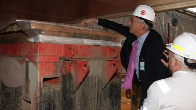 Matson President Ron Forest places ceremonial coins at the keel laying ceremony.
