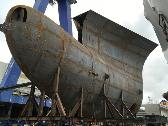 DKI's unpainted bulbous bow waits for installation
