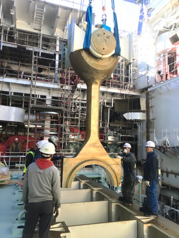 Philly Shipyard staff lower the connecting rod for installation