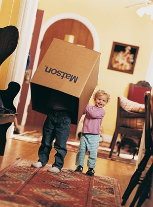 Children playing with Matson household shipping box